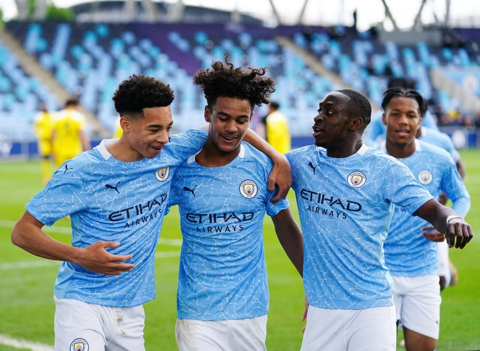 THREE CHEERS: Goalscorers Sam Edozie, Oscar Bobb and Carlos Borges get the party started against Fulham