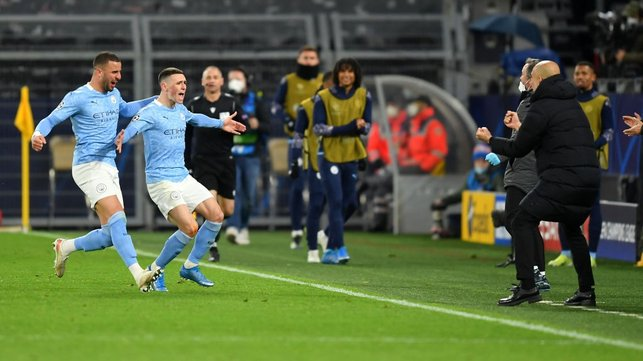 BOSSING IT: Foden runs straight to the boss after giving City the lead on the night