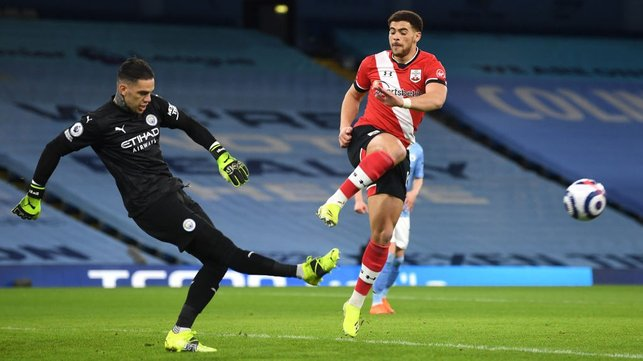 BETWEEN THE STICKS: Ederson clears his lines under the attentions of Che Adams