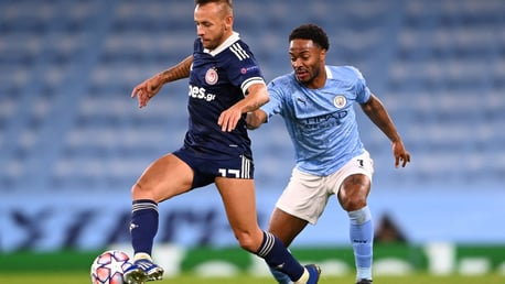 HIGH PRESS: Raheem Sterling defends from the front against Rafinha