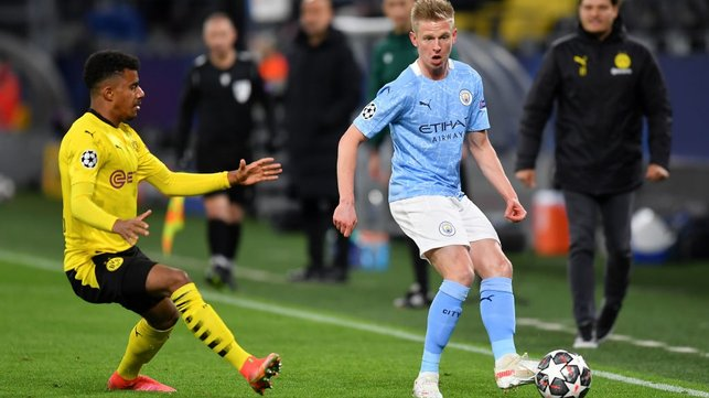 DOWN THE LINE: Oleks Zinchenko switches the play before Ansgar Knauff can pounce