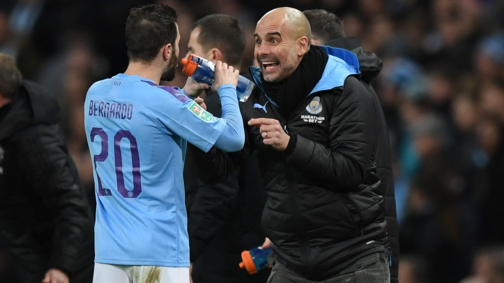 PEP TALK : Guardiola provides his instructions to Bernardo.