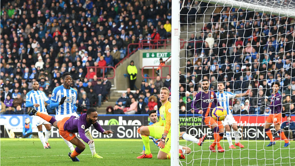 HEADS UP : Raheem Sterling swoops to head home City's second goal