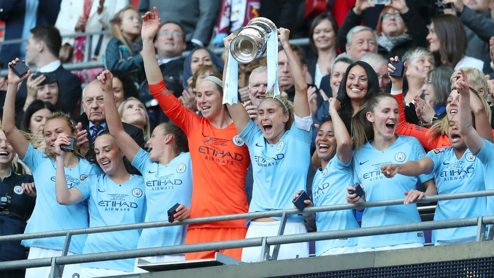 UP FOR THE CUP : Skipper Steph Houghton hoists the FA Cup aloft