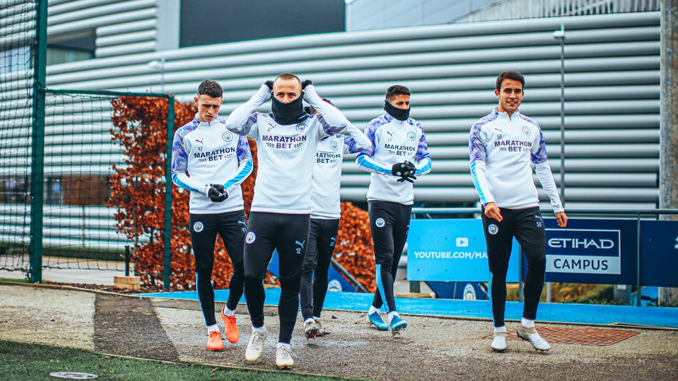 BOYS IN THE SNOOD! : The City players were dressed to keep out the January chill