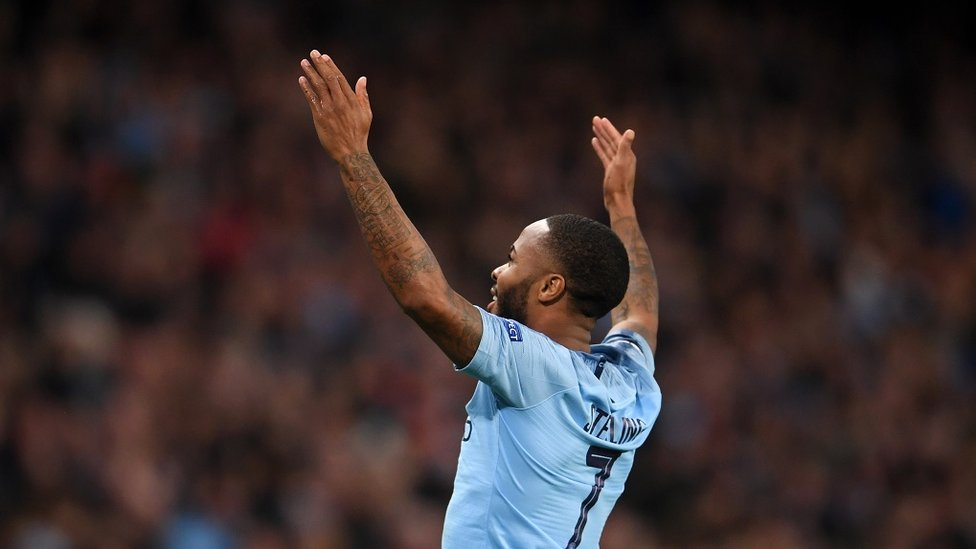 GOALDEN BOY : Raheem take the crowd's acclaim after curling home the third of the night