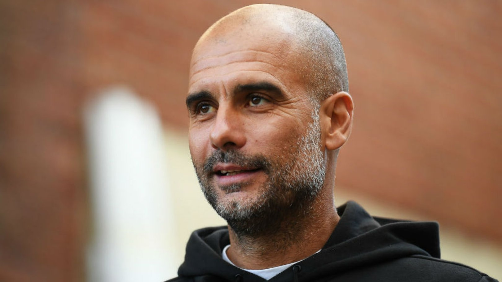 THE BOSS: Pep looks in relaxed mood as he arrives at Selhurst Park.
