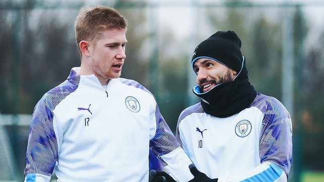 HATS THE WAY TO DO IT : Sergio Aguero takes time out to chat with Kevin De Bruyne
