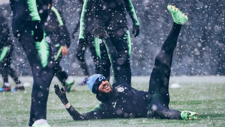 WHITE OUT: Bernardo Silva takes a tumble on the snowy surface!