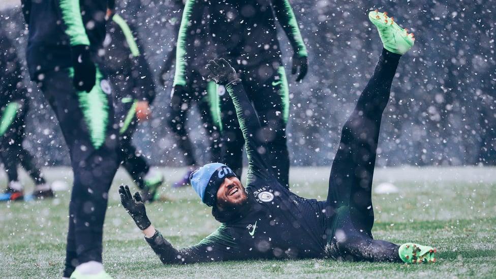 WHITE OUT : Bernardo Silva takes a tumble on the snowy surface!