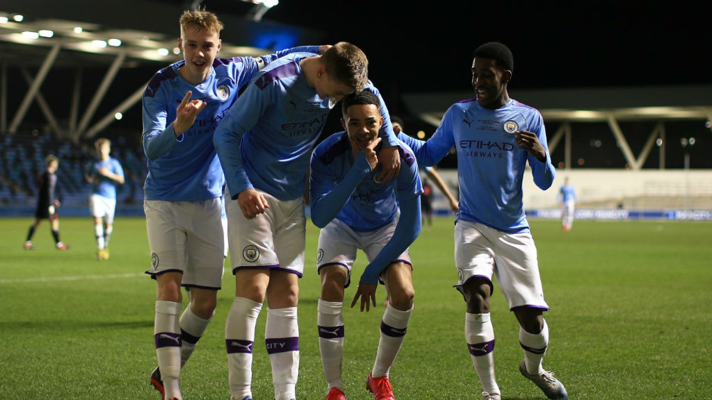 SQUAD GOALS: The City players celebrate after Sam Edozie's opener against Stoke