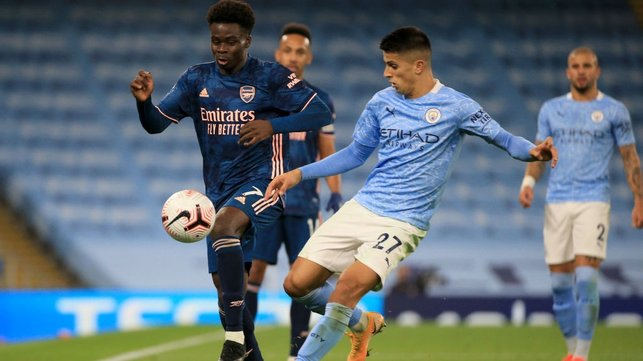 DEJA VU : Cancelo and Saka battle for possession again late in the game.